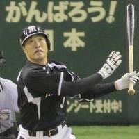 The swing that changed the game: Hanshin's Kentaro Sekimoto bashes a seventh-inning grand slam against Yomiuri on Sunday at Tokyo Dome. The Tigers defeated the Giants 6-4.  | KYODO