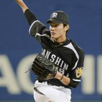 Dominating performance: Tigers hurler Shintaro Fujinami fans 13 batters in a Tuesday game against the Dragons at Nagoya Dome. Hanshin defeated Chunichi 8-1.  | KYODO