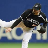 Fire ball: Hanshin's Randy Messenger delivers a pitch during the Tigers' 2-0 win over the Dragons on Wednesday. | KYODO