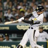 Clutch at-bat: Tigers slugger Kosuke Fukudome hits a solo home run in the 12th inning against the Giants on Tuesday at Koshien Stadium. Hanshin defeated Yomiuri 3-2.  | KYODO