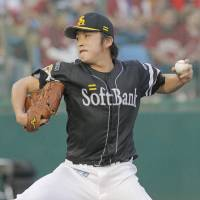 High flyer: Fukuoka Softbank starting pitcher Yuya Iida delivers during the Hawks' 3-0 win over the Eagles on Wednesday. | KYODO