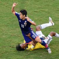 Must do better: Japan lost 4-1 to Colombia in its final game at the 2014 World Cup to exit the competition with a record of one draw and two defeats. | AFP-JIJI