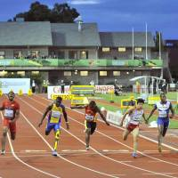 At the finish line: Yoshihide Kiryu (second from right) runs the 100-meter final in 10.34 seconds at the IAAF World Junior Championships on Wednesday. | KYODO