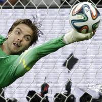 I got this: Netherlands goalkeeper Tim Krul saves the final penalty during the shootout against Costa Rica on Saturday. | AP