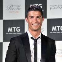 Famous face: Soccer superstar Cristiano Ronaldo, a new spokesman for MTG, a Nagoya-based company specializing in beauty and wellness products, meets the press on Tuesday in Tokyo.  | YOSHIAKI MIURA