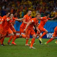 On to the next one: Netherlands players begin to celebrate after winning their penalty shootout against Costa Rica in the quarterfinals of the World Cup on Saturday. | AFP-JIJI