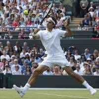 Clinicial: Roger Federer plays a return to Spain's Tommy Robredo during their men's singles match at Wimbledon on Tuesday. | AP