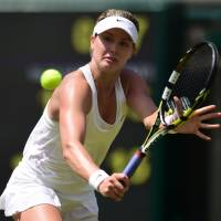 Stepping up: Canada's Eugenie Bouchard returns to Germany's Angelique Kerber in the women's singles quarterfinals at Wimbledon on Wednesday. Bouchard defeated Kerber 6-3,6-4. | AFP-JIJI