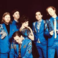 Here comes the night time: Arcade Fire includes Tim Kingsbury, Jeremy Gara, Regine Chassagne, Will Butler, Richard Reed Parry and (in front) Win Butler. The band will headline the main stage at Fuji Rock Festival on Saturday.