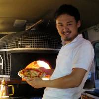 Bakka owner-pizzaiolo Yutaka Hazama has gone to the trouble of installing a classic wood-fired pizza oven in his truck.  | ROBBIE SWINNERton