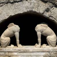 Two headless stone sphinxes are seen under a barrel-vault topping the entrance to an ancient tomb under excavation at Amphipolis. | AP