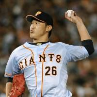 On fire: Tetsuya Utsumi winds up for a pitch, on his way to a five-hit shutout and a 3-0 victory for the Yomiuri Giants over the Yokohama BayStars at Yokohama Stadium. | KYODO