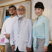 Film director Hideaki Anno (left), animator Hayao Miyazaki (center) and singer Yumi Matsutoya attend a press conference on the completion of Miyazaki's new animation film 'Kaze Tachinu' at Studio Ghibli in Koganei, Tokyo, on June 24, 2013. | KYODO