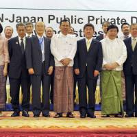 Trade minister Toshimitsu Motegi (front row, fourth from right) poses with representatives of the Association of Southeast Asian Nations during a conference on regional business promotion in Myanmar's capital, Naypyitaw, on Tuesday. | KYODO