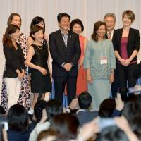 Prime Minister Shinzo Abe believes female participation in the workforce is one path to growth the nation must follow. He posed for a photo at the International Conference for Women in Business, in Tokyo on July 13. | KYODO