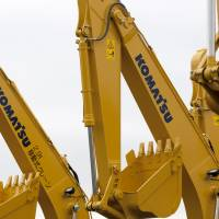 Komatsu Ltd. excavators bound for shipment sit at the company's plant in Hirakata, Osaka Prefecture. Japan's core machinery orders for the April-June quarter fell at their fastest pace since the global financial crisis, government data showed Thursday. | BLOOMBERG