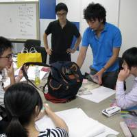 University students who will go to Myanmar in September to work on creating souvenirs in collaboration with local students take part in an orientation session in Saitama Prefecture on Aug. 10. | KYODO