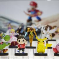'Amiibo' characters for the Wii U are displayed at the Nintendo booth during the Electronic Entertainment Expo in Los Angeles in June. Pikachu and Link will be among the first characters in its upcoming toys-meet-game franchise set for release later this year, it said Friday. | AP