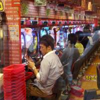 LDP eyes cellphone, pachinko prize taxes