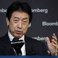 Yasuhisa Shiozaki, deputy policy chief of the Liberal Democratic Party, speaks at the Bloomberg Government Pension Investment Fund Conference in Tokyo on Tuesday. | BLOOMBERG