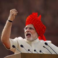 Indian Prime Minister Narendra Modi delivers an Independence Day address in New Delhi on Aug. 15. According to sources Thursday, New Delhi and Tokyo are nearing an agreement to jointly produce rare earth metals and export them to Japan as early as 2015. | AP