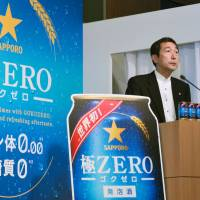 Sapporo Breweries Ltd. President Masaki Oga announces a new version of Sapporo Goku Zero with a higher liquor tax rate at a news conference in Tokyo on July 15. The National Tax Agency determined that its original product was ineligible for 'third category beer' status, which is taxed at a lower rate. | KYODO