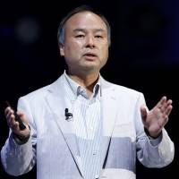Masayoshi Son, chairman and chief executive officer of SoftBank Corp., speaks at a media event in Tokyo in July. | BLOOMBERG