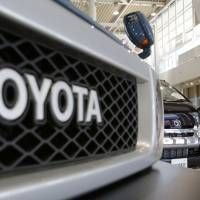 A visitor walks around a Toyota showroom in Tokyo on Tuesday. | AP