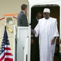 Mali President Ibrahim Boubacar Keita arrives at Andrews Air Force Base in Maryland on Sunday to attend the U.S.-Africa Leaders Summit. President Barack Obama is gathering nearly 50 African heads of state in Washington for an unprecedented summit. | AP
