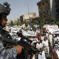 Defiant al-Maliki deploys special forces to key areas of Baghdad: police