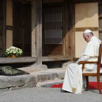 Pope Francis prays at the birthplace of St. Kim Taegon Andrea, the first Korean-born Catholic priest, at the shrine of Solmoe in Dangjin, South Korea, on Friday. | REUTERS