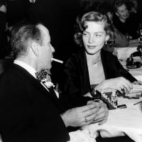 Lauren Bacall (left) sits with her husband, actor Humphrey Bogart, at the Stork Club in New York in this file photo from 1950. Bacall, a sultry-voiced Hollywood icon, and Humphrey Bogart's partner off and on the screen, died Tuesday in New York. | AP