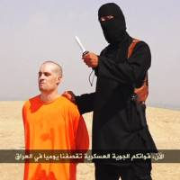 A frame from a video released by the Islamic State group Tuesday purports to show kidnapped journalist James Foley before he was allegedly beheaded by militants from the group. Foley, from Rochester, New Hampshire, went missing in 2012 in northern Syria while on assignment for Agence France-Press and the Boston-based media company GlobalPost. | REUTERS