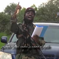 A screengrab taken Sunday from a video released by the Nigerian Islamist extremist group Boko Haram and obtained by AFP shows the leader of the Nigerian Islamist extremist group Boko Haram, Abubakar Shekau, delivering a speech at an undisclosed location. Boko Haram's leader said he has created an Islamic caliphate in a northeast Nigeria town seized by the insurgents earlier this month. 'Thanks be to Allah who gave victory to our brethren in (the town of) Gwoza and made it part of the Islamic caliphate,' he said in the 52-minute video. | AFP-JIJI