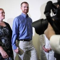 Dr. Kevin Brantly, who contracted the deadly Ebola virus, and wife, Amber, arrive at a Thursday press conference at Emory University Hospital in Atlanta.  Brantly a second American aid worker who contracted Ebola treating victims of the deadly virus in Liberia have recovered and were discharged by the Atlanta hospital that treated them with an experimental drug. | REUTERS