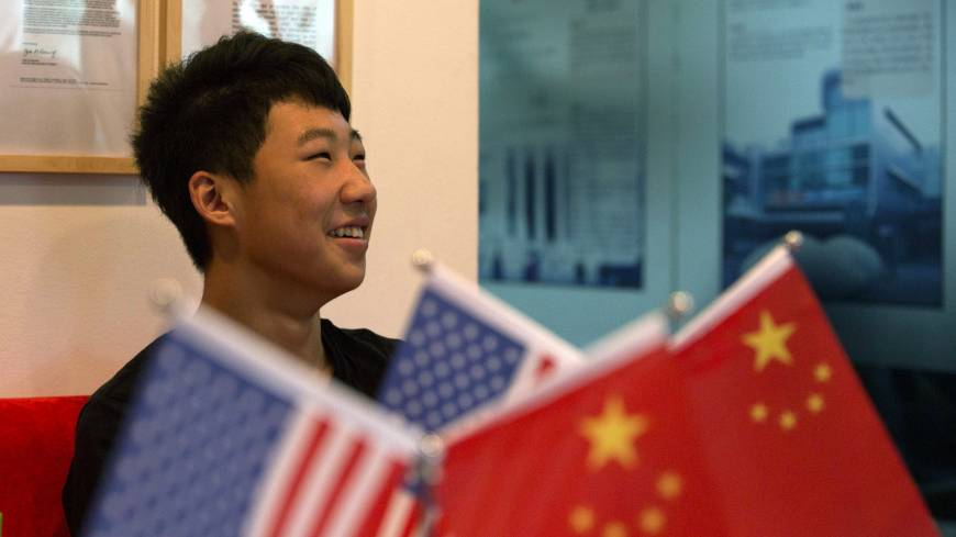 Zhang Kaisheng, 16, is interviewed in the lobby of the Beijing tutoring and consulting agency Focus Education on June 26. Like a growing number of Chinese teenagers, Zhang plans to enroll this fall in a private U.S. high school for a more expensive but well-rounded education. | AP