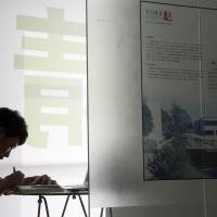 Zhang Kaisheng studies at Focus Education, a tutoring and consulting agency in Beijing, on June 26. He hopes to enroll this fall in a private U.S. high school. | AP