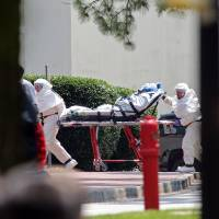 Nancy Writebol, an American aid worker from North Carolina who was infected with the Ebola virus while working in Liberia, arrives at Emory University Hospital in Atlanta on Tuesday. | AP