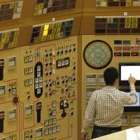 An employee checks a screen in a control room simulator at a Belgian nuclear power station in Tihange in March 2011. | REUTERS