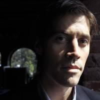 American journalist James Foley poses for a photo in Boston in May 2011. The beheading of Foley has forced a new debate over how the United States balances its unyielding policy against paying ransoms to terrorist groups and saving the lives of Americans being held hostage by some of the world's most dangerous extremists. | AP