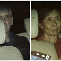 British corporate investigator Peter Humphrey and his wife, Yu Yingzeng, are seen leaving the Shanghai No. 1 Intermediate People's Court in a police vehicle on Friday. | REUTERS