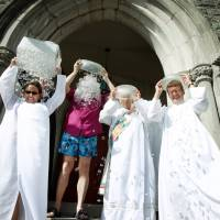 Members of the Episcopal Diocese of West Tennessee take part in the ALS Ice Bucket Challenge on the steps of St. Mary's Cathedral in Memphis on Thursday. | AP