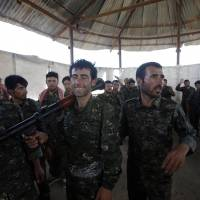 Islamic fighters kill scores of Yazidi men in Iraq