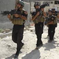 Members of the Iraqi Special Operations Forces conduct a patrol looking for militants of the Islamic State, formerly known as the Islamic State in Iraq and the Levant, in a neighborhood in Ramadi on July 22. | REUTERS