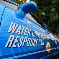 A 'water policeman' with the Water Conservation Response Unit in Los Angeles returns to his vehicle after inspecting a neighborhood in Studio City, California, on Aug. 19, He was looking for homes or businesses that were wasting water amid California's latest drought. | AFP-JIJI