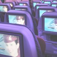 Qatar Airways demonstrates economy-class entertainment screens on a Boeing 787 Dreamliner at the Dubai Airshow in the United Arab Emirates last November. | BLOOMBERG