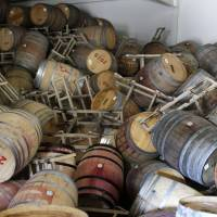 Barrels filled with Cabernet Sauvignon are seen toppled onto one another at the B.R. Cohn Winery barrel storage facility in Napa, California, following Sunday's earthquake. | AP