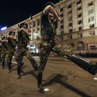 Ukrainian soldiers rehearse in Kiev on Wednesday for an Independence Day parade this weekend. NATO's commander has said the alliance would react militarily if Russian troops infiltrated a member state's territory in the way they apparently did in Crimea. | REUTERS