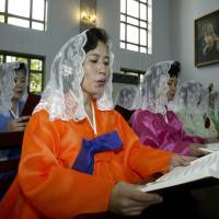 North Koreans attend Mass at a Catholic church in Pyongyang on Aug. 17, 2003. | REUTERS