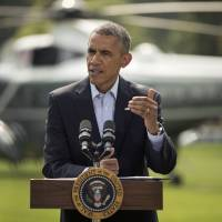 President Barack Obama speaks on the South Lawn of the White House in Washington on Saturday about the ongoing situation in Iraq before his departure on Marine One for a vacation in Martha's Vineyard. | AP